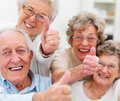 Success - Older people giving thumbs up Royalty Free Stock Photo