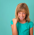 Success. Portrait winning successful little girl happy ecstatic celebrating being winner isolated turquoise background. Royalty Free Stock Photo