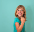 Success. Portrait winning successful little girl happy ecstatic celebrating being winner isolated turquoise background. Positive Royalty Free Stock Photo