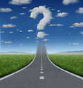 Success questions and uncertain strategy with a road or highway going up to the sky fading into a cloud shaped as a question mark Royalty Free Stock Images