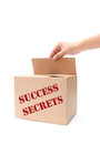 Success secrets hand opening a box containing of Royalty Free Stock Photos