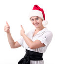 This is a success simple young woman in santa s hat Royalty Free Stock Photos