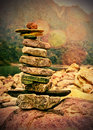 Success to life stability and equilibrium stack of pebbles arranged one over the other illustrating the concept of a calm stable Royalty Free Stock Photography