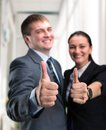 Success two young happy people showing victory sign Stock Photos