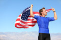 Success winner athlete cheering with usa flag celebrating victory fit american male winning fitness running model in celebration Royalty Free Stock Photos