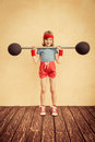 Success and winner concept funny strong child with barbell girl power feminism sport fitness kid Royalty Free Stock Images