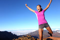 Success winner fitness runner woman jumping happy excited and energetic with happy cheering face expression celebrating sporty Stock Photo