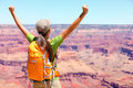 Success winner person happy hiker in grand canyon woman cheering with arms raised up winning gesture enjoying the beautiful Stock Photo