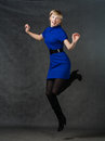 Success young active businesswomen jumping in dancing s female blue dress studio shot Royalty Free Stock Photography
