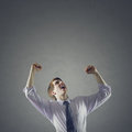 Success young business man with the arms up Stock Photo
