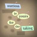 Success is yours for the taking bulletin board pieces of paper each containing a word pinned to a cork reading motivating you to Royalty Free Stock Photos