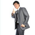 Successful Asian businessman giving thumbs up Royalty Free Stock Photos