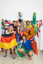 Successful athletes with various national flags portrait of celebrating at home Royalty Free Stock Photos