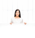 A successful and beautiful business woman with a banner young confident the blank billboard Stock Image