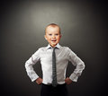 Successful business baby funny photo of over dark background Royalty Free Stock Images