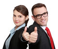 Successful business couple with thumbs up isolated against a white background Stock Photography