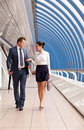 Successful business couple walk down the hall in the center Royalty Free Stock Photos