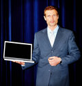 Successful business man presenting laptop Stock Photography