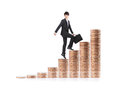 Successful business man sitting on money stairs walking coin with smile isolated against white background asian male model Royalty Free Stock Photos