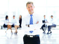 Successful business man standing with his staff Royalty Free Stock Photo