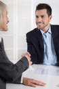 Successful business meeting with handshake: customer and client. Royalty Free Stock Photo