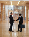 Successful business men greeting eachother Royalty Free Stock Image