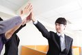 Successful business people group celebrating with hands giving high five at office asian Royalty Free Stock Photo