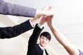 Successful business people group celebrating with hands giving high five at office asian Royalty Free Stock Photography