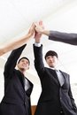 Successful business people group celebrating with hands giving high five at office asian Royalty Free Stock Photos
