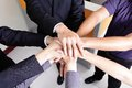 Successful business people group celebrating with hands giving high five at office asian Royalty Free Stock Images