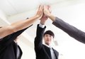 Successful business people group celebrating with hands giving high five at office focus on hans asian Royalty Free Stock Photo