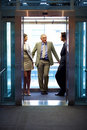 Successful business people standing in elevator Stock Photography