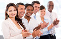 Successful business team applauding at the office looking happy Stock Photos