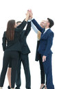 Successful business team giving a high fives gesture as they lau Royalty Free Stock Photo