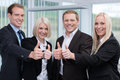 Successful business team giving a thumbs up motivated young gesture of success approval and agreement Stock Image