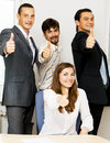 Successful business team showing thumbs up Stock Photo