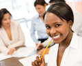 Successful business woman black women at the office looking very happy Stock Image