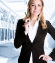 Successful business woman businesswoman talking on the phone waiting for a partner serious people success and career concept Stock Images