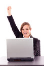 Successful business woman celebrating victory while sitting at o office desk isolated over white background Royalty Free Stock Photography
