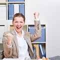 Successful business woman cheering Royalty Free Stock Photo