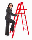Successful business woman climbing a red ladder Stock Photo