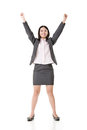 Successful business woman hands up asian happy for success feels like a winner full length portrait isolated on the white Royalty Free Stock Photo