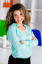 Successful business woman at her work place smiling Royalty Free Stock Image