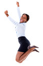 Successful business woman jumping with arms up isolated over white Stock Image