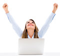 Successful business woman with laptop and arms up isolated over a white background Royalty Free Stock Images
