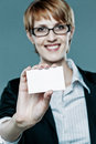 Successful business woman showing her card background Stock Photo