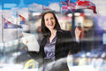 Successful business woman smiling portrait with note pad and international flags Royalty Free Stock Photo