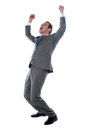Successful businessman celebrating with arms up Stock Photography