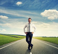 Successful businessman in formal wear standing on the road Stock Photo