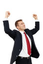 Successful businessman holding arms up success portrait of with clenched fist and an image of victory a winner isolated on white Royalty Free Stock Images